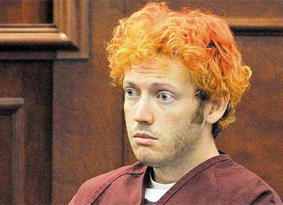 <b>CORINGA:</b> James Holmes, o atirador que matou 12 pessoas na estreia de 'Batman' nos EUA, fez a primeira aparição ontem diante de um juiz para procedimentos legais